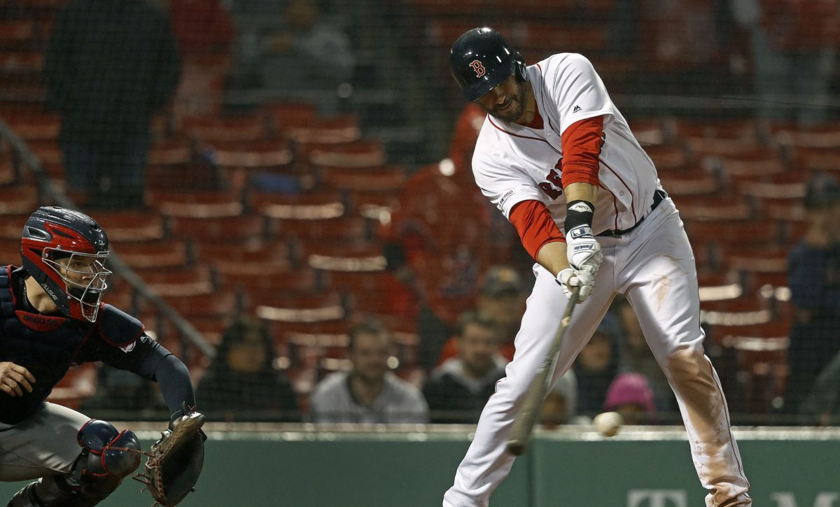 J.D. Martinez Reaches for a Pitch (courtesy the Boston Globe)