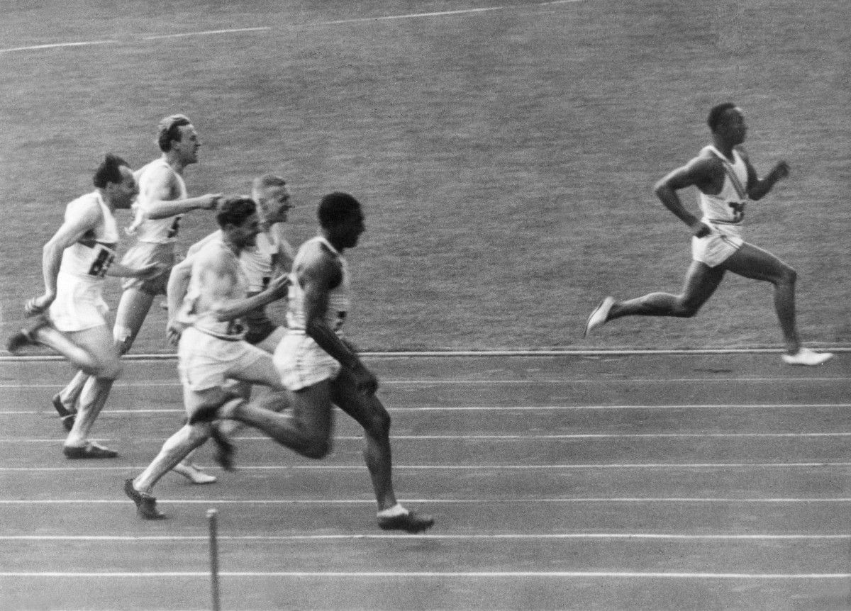 Jesse Owens Dominating at the 1936 Berlin Olympics (courtesy Biography.com/Getty Images)