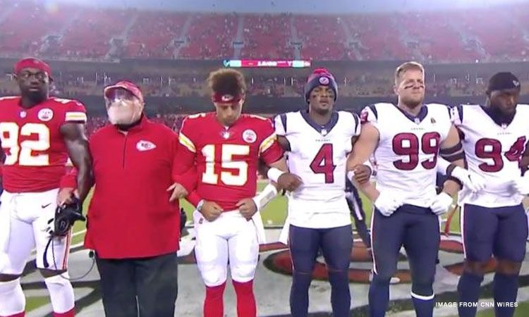 The Kansas City Chiefs and Houston Texans lock arms in a moment of unity before the 2020 NFL Kick Off (photo courtesy CNN)