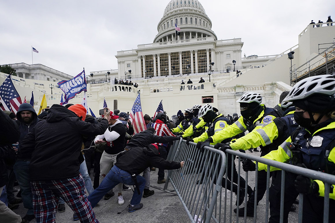 Capitol Hill Riots (Supporters of President Donald Trump's try to break through a police barrier on Wednesday at the Capitol in Washington.   Julio Cortez/AP Photo)