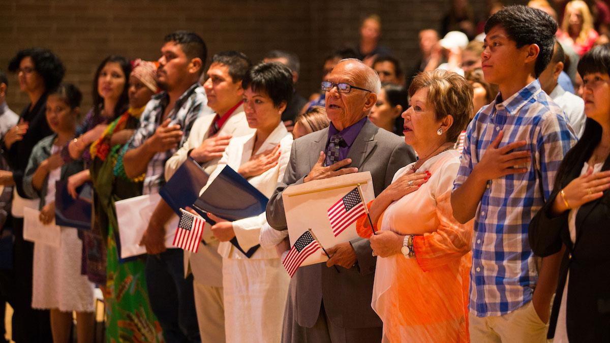 American Naturalization Ceremony (from: https://blogs.missouristate.edu/publicaffairs/files/2017/08/naturalization-ceremony.jpg)