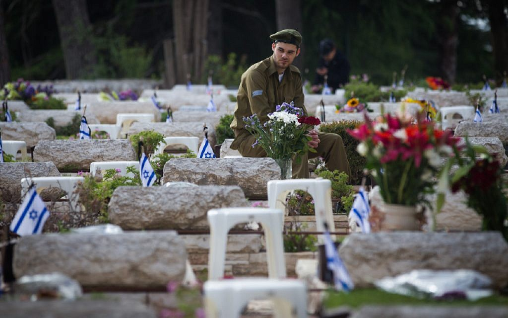 Israeli Soldier Morning at Graves (photo credit: Miriam Alster/Flash90)