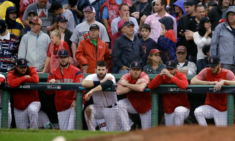 Boston Red Sox players and fans watch the last moments of Game 4 in baseball's American League Division Series, Monday, Oct. 9, 2017, in Boston. The Houston Astros eliminated the Red Sox with a 5-4 victory. (AP Photo/Charles Krupa) ORG XMIT: NYOTK