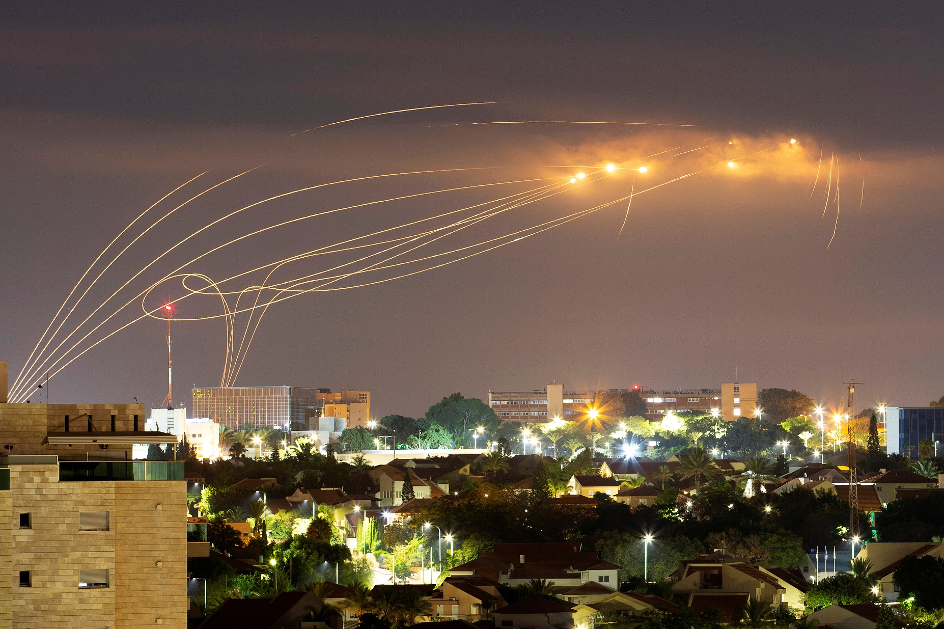 The Iron Dome anti-missile system fires interception missiles as rockets are launched from Gaza towards Israel, as seen from the city of Ashkelon, Israel, August 21, 2020. REUTERS/Amir Cohen